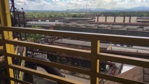 Pohled z ochozů vysoké pece na Acelor Mittal (dříve Nová huť Klementa Gottwalda) a Beskydy v pozadí.